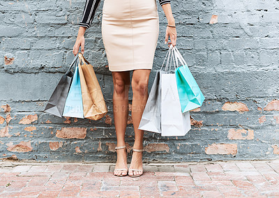 Buy stock photo Cropped shot of a stylish young woman shopping in the city