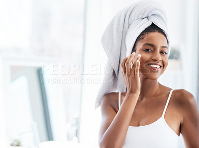 Buy stock photo Portrait of a beautiful young woman going through her morning beauty routine at home