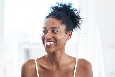Buy stock photo Shot of a beautiful young woman going through her morning beauty routine at home