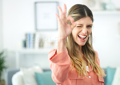 Buy stock photo Cropped shot of a beautiful young woman showing the ok sign