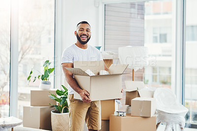 Buy stock photo Portrait of a young man carrying a box while moving house