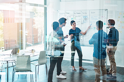 Buy stock photo Shot of a group of businesspeople having a meeting in a modern office
