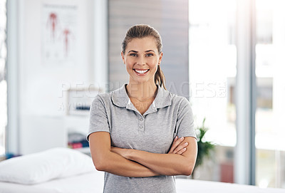 Buy stock photo Portrait of a confident young physiotherapist standing in her office
