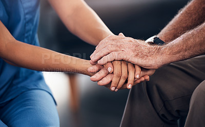 Buy stock photo Cropped shot of a senior man and a nurse holding hands