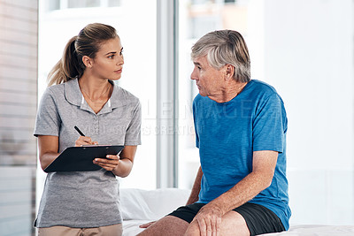 Buy stock photo Shot of a young physiotherapist having a consultation with a senior man