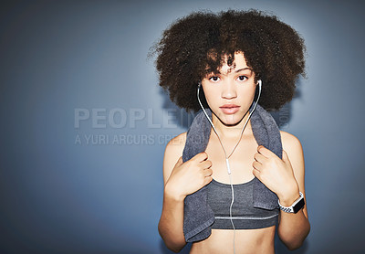 Buy stock photo Studio portrait of an attractive young female athlete posing against a grey background