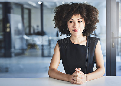 Buy stock photo Portrait of a beautiful young businesswoman sitting at her office desk at work