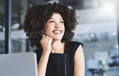 Buy stock photo Shot of a cheerful young businesswoman looking thoughtful while working in her office