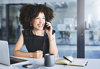 Buy stock photo Shot of a cheerful young businesswoman taking a phone call in her office