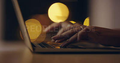 Buy stock photo Shot of an unrecognizable businesswoman using a laptop while working late in her office