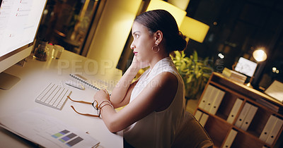 Buy stock photo Shot of a beautiful young businesswoman looking exhausted while working late in her office