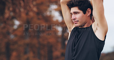 Buy stock photo Shot of a sporty young man stretching before his workout