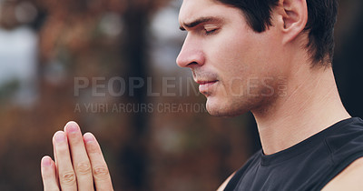 Buy stock photo Shot of a sporty young man standing with his hands clasped