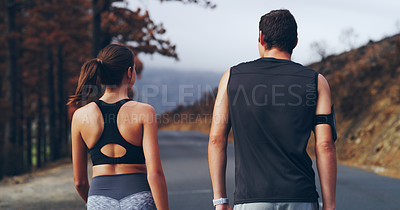Buy stock photo Rearview shot of a young couple walking outdoors