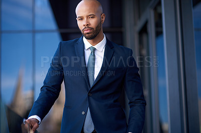 Buy stock photo Portrait of a handsome young businessman standing outside an office building