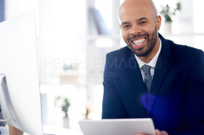 Buy stock photo Portrait of a handsome young businessman using a digital table while working in his office