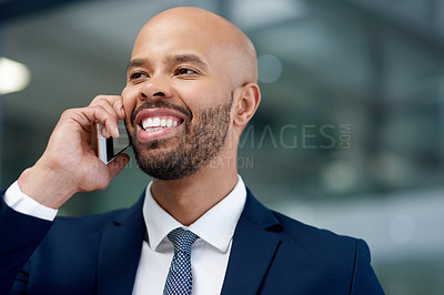 Buy stock photo Shot of a handsome young businessman taking a phone call in his office