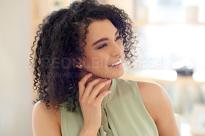 Buy stock photo Cropped shot of an attractive young businesswoman looking thoughtful while working at her desk in the office