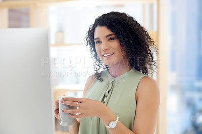 Buy stock photo Cropped shot of an attractive young businesswoman drinking coffee while working at her desk in the office