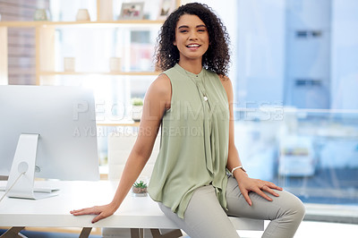 Buy stock photo Cropped portrait of an attractive young businesswoman sitting on her desk in the office