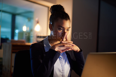 Buy stock photo Shot of a young businesswoman looking anxious while working on a laptop in an office at night