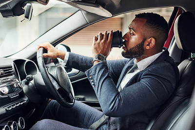 Buy stock photo Cropped shot of a man drinking a takeaway coffee while driving