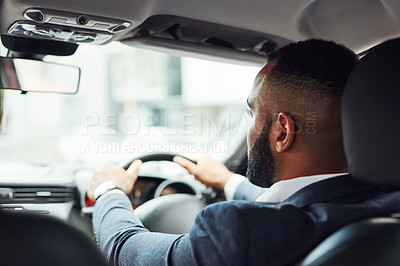 Buy stock photo Rearview shot of a young man driving a car
