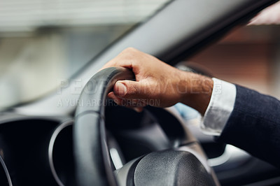 Buy stock photo Cropped shot of an unrecognizable man's hand on a steering wheel