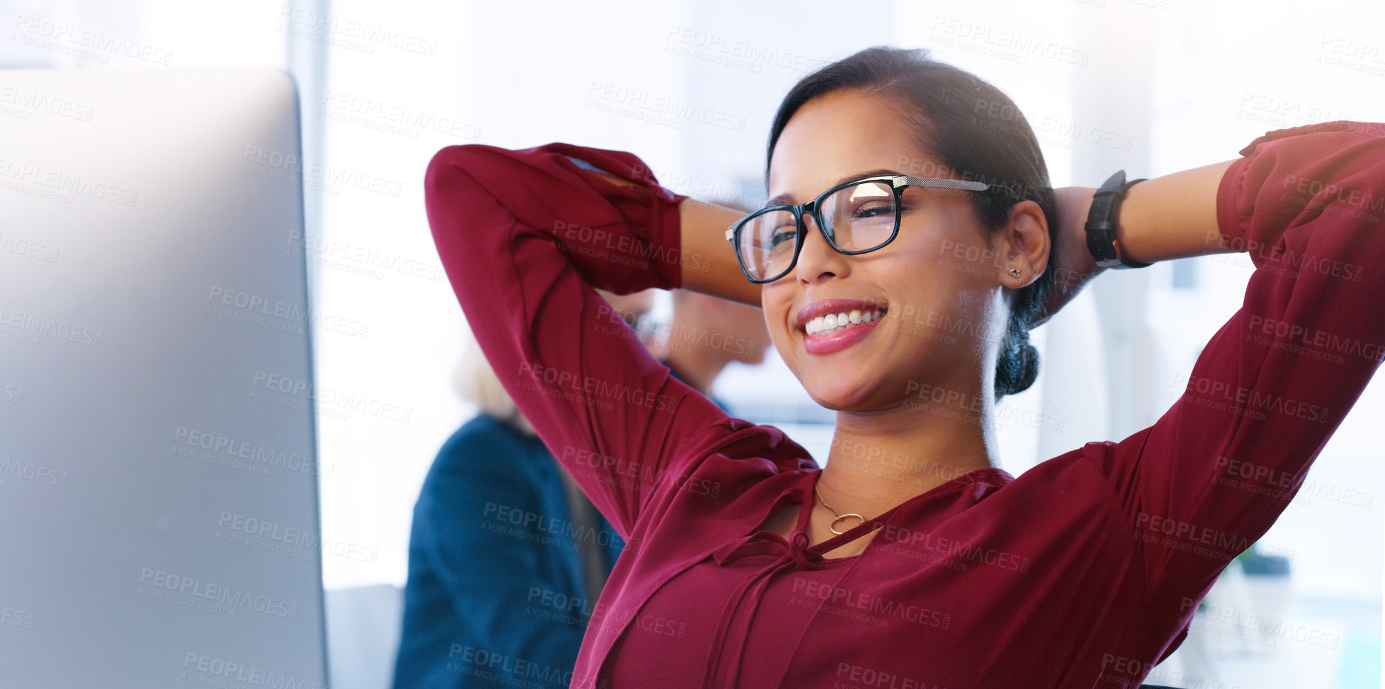 Buy stock photo Cropped shot of a carefree young businesswoman sitting back in her chair and taking a break inside of the office