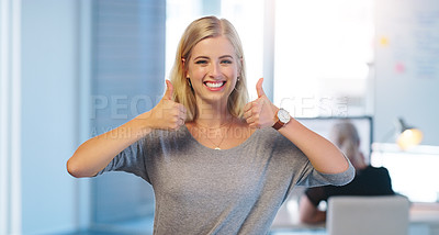 Buy stock photo Portrait of a confident young businesswoman showing thumbs up while standing inside of the office at work