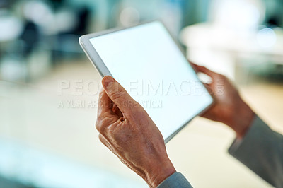 Buy stock photo Closeup shot of an unrecognizable businesswoman using a digital tablet while working in an office at night