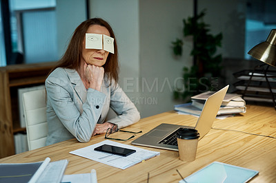 Buy stock photo Shot of a mature businesswoman sitting at her desk with sticky notes covering her eyes