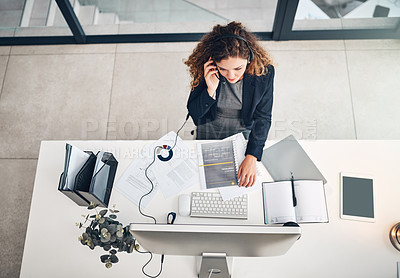 Buy stock photo High angle shot of a young businesswoman working in a call centre