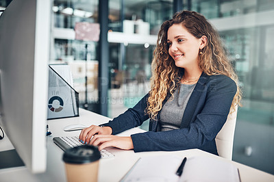 Buy stock photo Shot of a young businesswoman working on a computer in an office