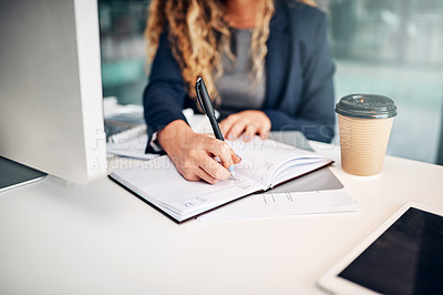 Buy stock photo Closeup shot of a businesswoman writing notes in an office