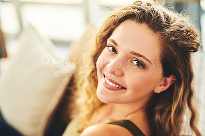 Buy stock photo Portrait of a happy young woman relaxing on the sofa at home