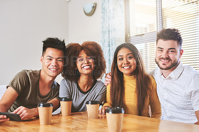 Buy stock photo Portrait of a group of cheerful young friends seated together while having coffee at home during the day