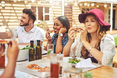 Buy stock photo Cropped shot of a group of carefree young friends having lunch together at a table outside during the day