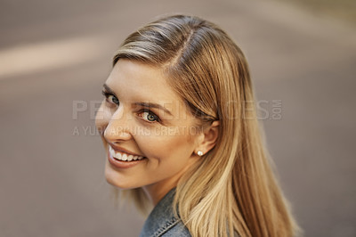 Buy stock photo Cropped portrait of an attractive young female student sitting alone on campus