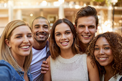 Buy stock photo Cropped portrait of a group of college students taking a selfie together in between classes on campus