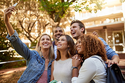 Buy stock photo Cropped shot of a group of college students taking a selfie together in between classes on campus