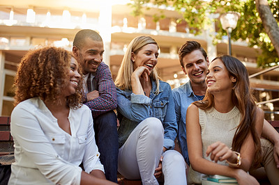 Buy stock photo Cropped shot of a group of college students having a discussion while enjoying their free time on campus