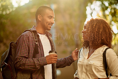 Buy stock photo Cropped shot of a young couple having a discussion while standing on campus