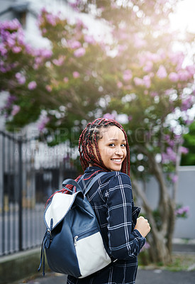 Buy stock photo Cropped portrait of a young female university student looking excited on her way to class outdoors