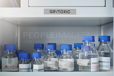 Buy stock photo Shot of labeled bottles with liquid in them in a modern laboratory