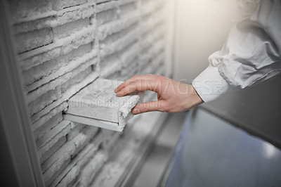 Buy stock photo Cropped shot of a scientist removing a sample from a laboratory freezer