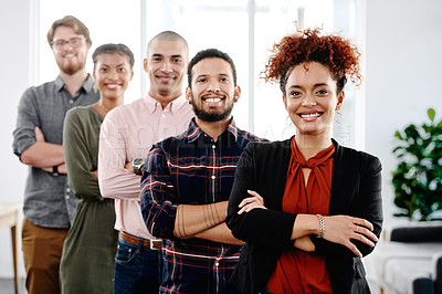 Buy stock photo Portrait of a group of young businesspeople posing with their arms folded in an office