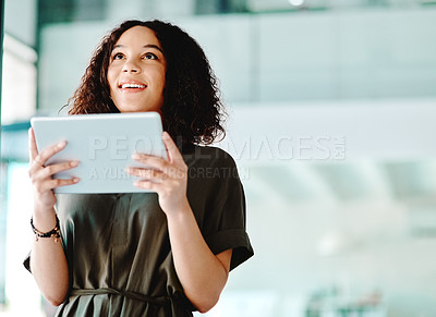 Buy stock photo Cropped shot of a young woman using a digital tablet at the office