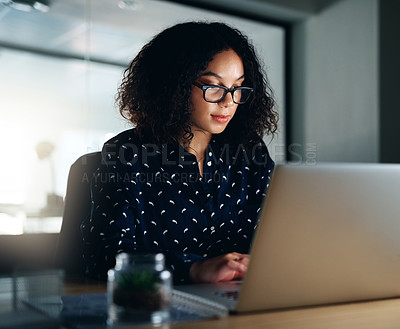 Buy stock photo Shot of a businesswoman working late at the office