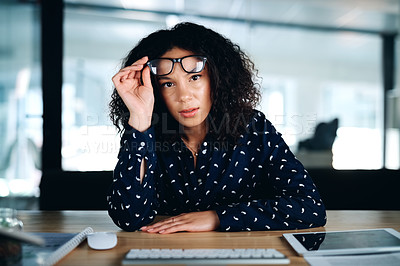 Buy stock photo Cropped shot of a businesswoman looking stressed while sitting at her desk